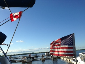 The stern of the Joint Adventure displaying the American flag and a courtesy Canadian flag while in Canada