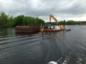 A dredge on the Hudson River removing sediment laced with PCB's