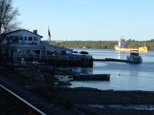 Docked for the night at Mariner's Restaurant in Poughkeepsie while a tanker passes by