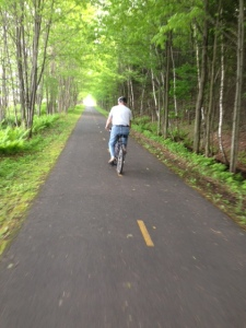 Tom riding along the bike path in Sorel, Quebec - this off-road path goes for miles and miles and eventually will take you to Quebec City or elsewhere in Quebec