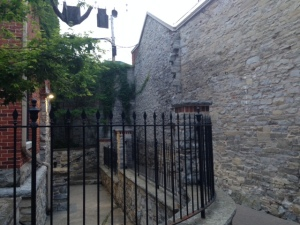 One of the many picturesque stone alleyways in Kingston - abundant limestone and a large supply of stone masons looking for work after the Rideau Canal was completed caused many of the buildings in Kingston to be constructed of stone
