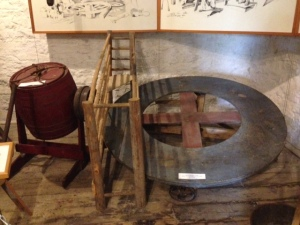 An interesting exhibit in the Blockhouse Museum - everyone had to pull his own weight in the old days, including Fido - this is a dog-powered butter churn.  The dog was put in the cage on the left side of the wheel.  As the dog walked forward (enticed by some food, perhaps?), the dog turned the wheel upon which it was standing, which in turn operated the churn on the left, connected by a pulley to the wheel. Where was the SPCA?
