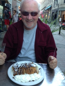 Tom salivating over a fruit/chocolate/ice cream desert crepe after dinner at a sidewalk café in the Old City