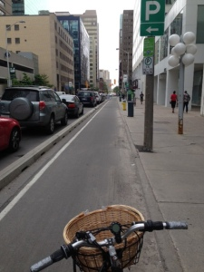 For you bikers, Ottawa is a very bike-friendly place with bikes everywhere. Here is the best design for an urban bike lane - parked cars are moved away from the sidewalk and a second curb is put in to delineate a fully-protected bike lane and keep parked cars out of the bike lane