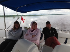Kathleen, Mary, and Ted enjoying the scenery on the Ottawa River - notice the Canadian courtesy flag in the background (now hung right side up)