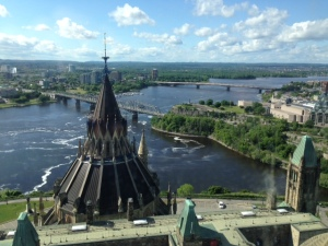 View of the Ottawa River from the observation deck in the Parliament Building. The French-speaking city of Hull, Quebec, is on the far side of the river (on the left in the photograph)