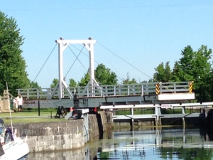 This is a swing bridge located at one of the locks - after manually opening the gates to the lock, the lockmaster and his assistant literally push one end of the bridge sideways to swing it open, then push it on the opposite side to close it after we pass.