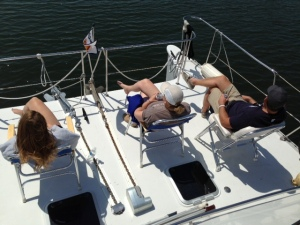 "Relaxing on the ""front porch"" as we transit a calm portion of the Seaway - the Joint Adventure is 17' wide.  While creating some docking challenges at times, it affords a very generous amount of deck space"