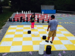 One of the shops features a people-size checkers game and chess game