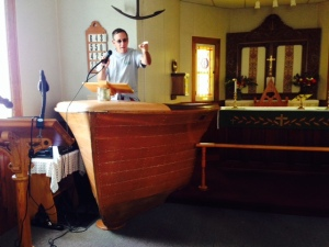 "Jim telling us to ""REPENT!""  The pulpit in the Anglican Church in Kagawong is the bow of a boat"