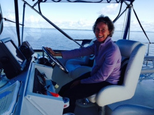The cold didn't seem to bother Chrissie as she expertly piloted the boat