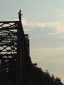 I could lie and pretend this was me getting ready to jump off the top of the abandoned railroad bridge, but everyone knows I'm really a wuss - it's a local kid who came for swim late in the day