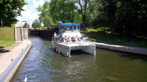 The joint Adventure departing a lock