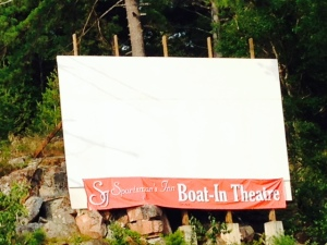 You've heard of a drive-in - Killarney has a boat-in.  The movie is projected on the screen which faces the docks and you tune into a particular channel on the FM radio and watch the movie from your boat