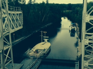 This picture is taken from the walkway at the top of the lock after we descended - the right-hand chamber is at the bottom and you can see the left-hand chamber suspended in the air on the left side of the picture. The Joint Adventure is tied to the wall at the bottom.