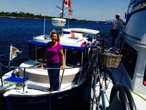 Our new friend Tania, whom we met along the way, was unable to get a place to dock at Little Current to stop for lunch, so she rafted up to us for a few hours. Her boat is a really cool 25' Nordic Tug that is perfectly set up for her