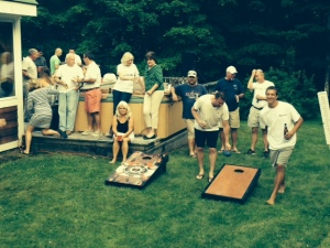 "The ""cornhole"" tournament finals were held back at the ski house Saturday evening"