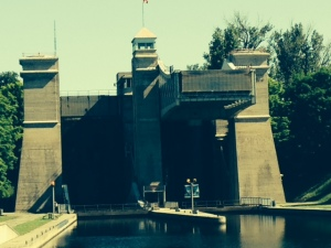 This is the view approaching the lock in the boat.  There are two chambers - the one on the right is in the air, at the level of the canal above, 6 1/2 stories higher than the level we are on.  We enter the chamber on the left after a gate at the entrance to the chamber submerges so we can pass over it