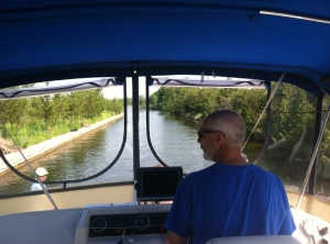 Paul taking a stint at the wheel through a narrow section of canal