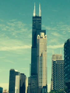 "Chicago offers an ""Architecture Tour"" - a narrated boat tour that highlights and describes the architecture and history of many of the significant buildings in Chicago - this is the Sear Tower (now the Willis Tower) with another building in front of it"