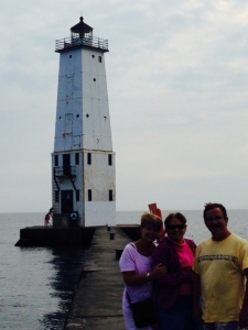 Wendy, Trish, and Nif on the jetty that goes out to the lighthouse