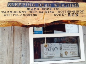 A sign in Fishtown to assist tourists in determining the weather at Sleeping Bear Park