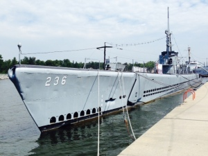 A World War II sub that is docked at the Veterans Museum adjacent to the beach and channel entering Muskegon. The Museum focuses on the role of submarines in World War II, and provides guided tours of the sub