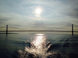 The Mackinaw Bridge with the sun rising in the background