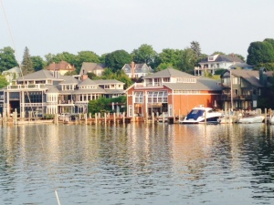 Homes right down to the waters edge line a portion of Charlevoix Harbor