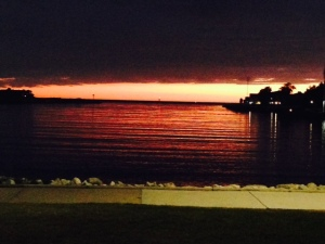 A late evening sunset over Ludington Harbor and Lake Michigan