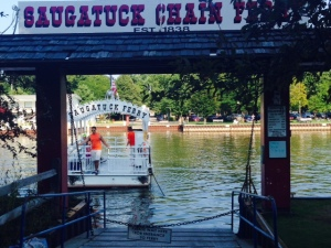 Saugutuck has a chain ferry that will take you across the river on demand - the ferry is literally connected to a chain that rests on the bottom and is attached to the ferry dock on each side. The operator (a college student) turns a crank on the ferry by hand, which pulls the ferry along the chain from one side to the other. It costs $1 - bikes are free!