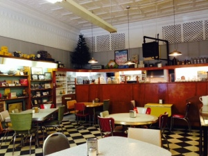 The room with the soda fountain also included a pharmacy in years past - the proprietor converted it to a restaurant, retaining the old pharmacy counter, seen at the rear, and the old merchandise shelving, seen on the left