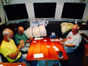 If we're not near a town, a restaurant, or other place to visit, we often watch a movie on board, either streamed from Netflix or one of the 50 or so DVD's we have on board. this evening, we played cards for a change of pace - I lost (as usual). Left to right, Paul, Hank (my Dad), and Tom