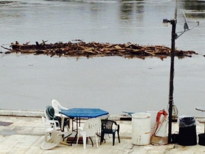 Debris passing by the barge at Hoppies