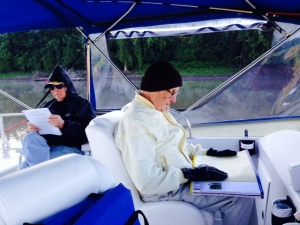 My Dad, concentrating on his chores as Navigator, with Tom in the background. This was taken early in the morning, so as you can see by the hat and gloves, it was chilly - actually, a welcome relief after a stretch of very hot weather most of the time since we reached Chicago