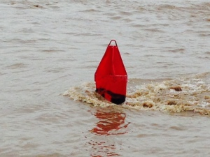 Hard to tell from the picture how fast the current is running, but this is the type of large steel buoy that were pulled completely under water by the high water and strong current, just waiting to punch a whole in someone's hull