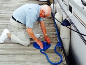 My Dad making sure our lines on the dock are ship shape - if only we kept the inside of the boat so neat and organized...