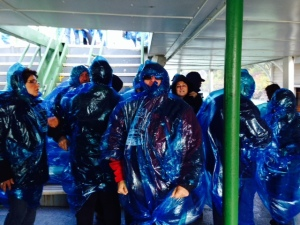 Donning the raincoats (I use the term lightly...) on the Maid of the Mist. Between the wind and the spray next to the Falls, I'm not sure the raincoats did much good...