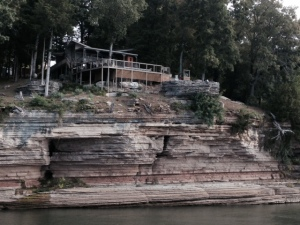 Notice the hot tub in the rock enclosure overlooking the edge of the cliff.  I could live here....
