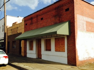 At least half of the storefronts in downtown Aliceville are boarded up and vacant