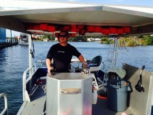 Jeff guiding the boat to the springs in search of manatee