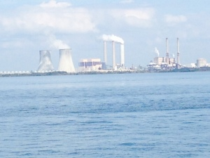 The Crystal River power plant located on the Gulf at the mouth of Crystal River. The nuclear reactor was permanently shut down in 2013 after a gap in the concrete containment building was discovered during a routine maintenance and upgrade. The gap was apparently caused earlier when workers cut the concrete containment to  replace a generator. The four coal-fired plants on the site continue to operate.