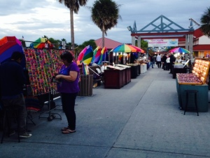 "Street vendors lining the long pier known as ""Pier 60"""