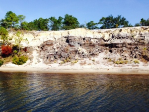 A sand cliff along the Gulf Intracoastal Waterway