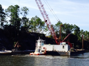 A dredge working to clear erosion that has washed into the Waterway