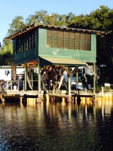 Notice the sling for the boat lift under the house - a modest house, but a great place to store your boat under cover with instant access to it -