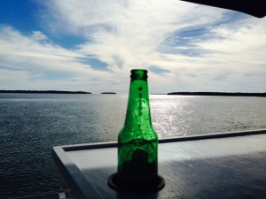 The view from the bridge of the Joint Adventure at anchor - the opening to the Gulf from the Ten Thousand Islands is in the background. Somehow this empty Heiniken bottle ended up in the foreground...