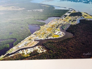 As seen in this aerial photo of Everglade City, the town is built on a small area of upland (much of it filled) and is surrounded by mangrove swamp. The narrow and sometimes shallow channel winds for six miles through the Ten Thousand Islands and Chokoloski Bay