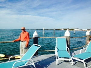 My Dad enjoying the view from the deck at the Tiki Bar at the marina -