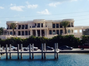 We looked up this house on the internet - located in Deerfield Beach with the oceanfront beach in back and a dock for a megayacht in front, it is the most expensive house currently on the market in the entire USA. With 8 bedrooms and 13 baths, it can be had for a mere $139 million. Maybe the seller would take back a second mortgage....